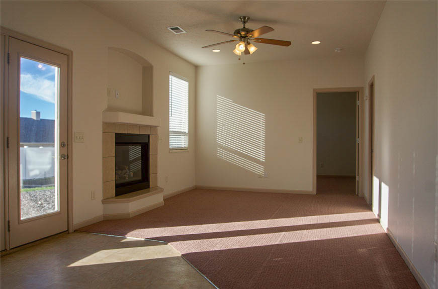 161 Sun Hawk family room with gas fireplace & ceiling fan