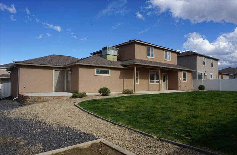 Spacious back yard has timed & pressurized irrigation & mature landscaping.