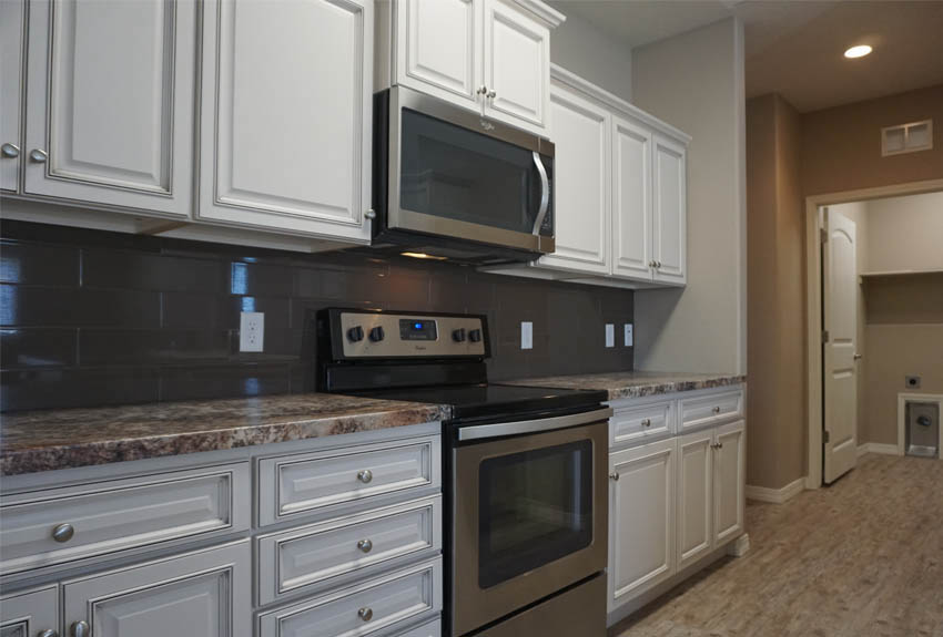 Galley-style kitchen ends at the laundry room