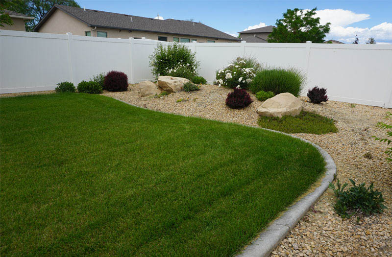 Landscaping is watered by a timed & pressurized irrigation system.