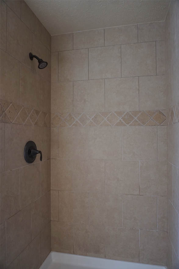 Step-in shower in the master bath of 189 Winter Hawk Drive