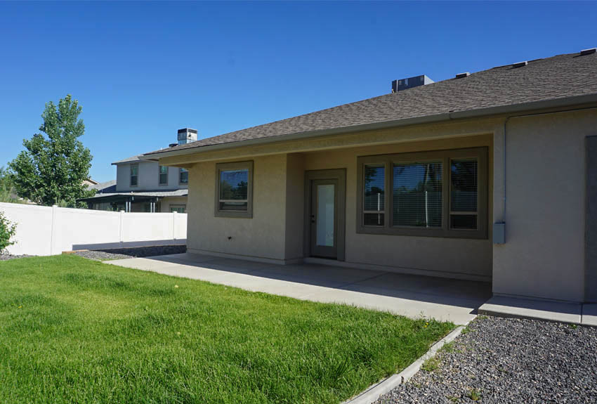 Partially covered back patio of 2997 Black Hawk Way, Grand Junction, CO