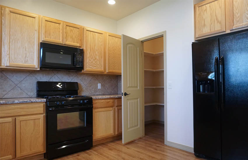the kitchen of 2997 Black Hawk Way includes a walk-in pantry.