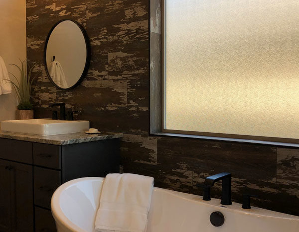 Today's Wow Wednesday features a rustic wood-look tiled master bath with a gorgeous soaking tub, double vanities, and a walk-in shower.