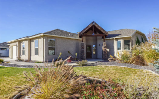 287 Sun Hawk Drive is a 4 bedroom, 2 bath home with an open concept living area, large master suite with a private patio, 5-piece bath, and walk-in closet. It has a 3-car garage + RV parking and a large back yard with a dedicated garden area and timed & pressurized irrigation.
