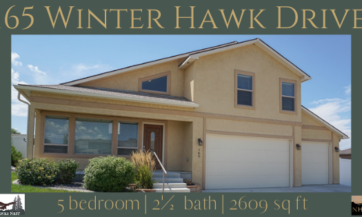 165 Winter Hawk Dr is a 5 bedroom, 2½ bath 2609 square foot tri-level home in Hawks Nest on Orchard Mesa. It has a 3 car garage, RV parking, and multi-level back yard with dual patios.